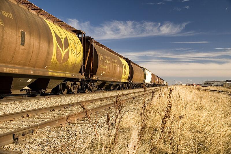 Canadian railway car riding along a bare field